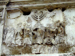 Photo of relief showing menorah being taken from temple.