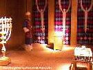 Color photo of recreation of tabernacle, view of inside the Holy Place, showing a priest, the lampstand, the table of shewbred, and the altar of incense from 'Great Passion Play' copyright Elna M. Smith Foundation.